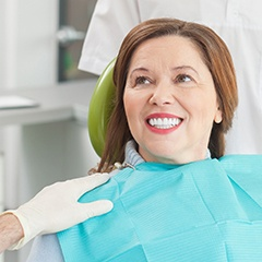 Smiing woman in dental chair