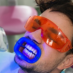 Man receiving in-office whitening treatment