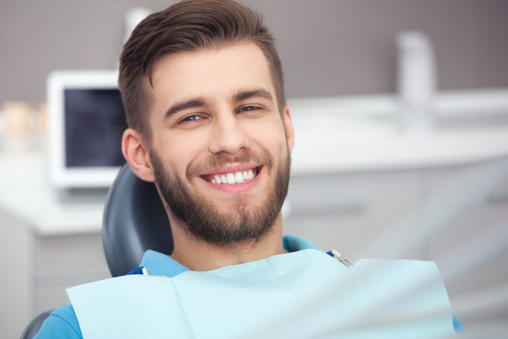 Man with brown hair having a consultation for dental implants
