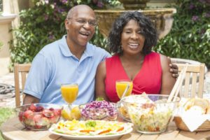 couple with dental implants in Sunnyvale eating outside