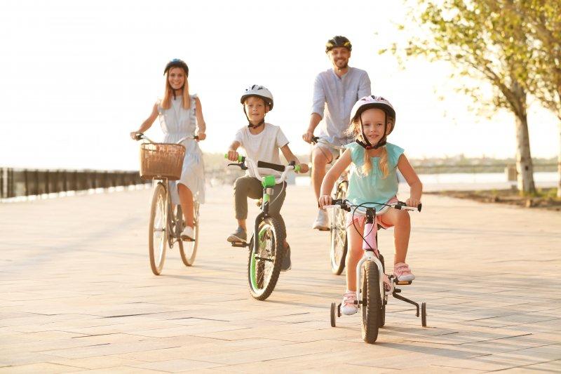 family biking together during summer